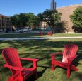 red chairs on campus lawn
